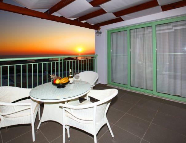 meltemi villas - balcony during sunset